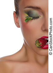 charming woman with strawberry in mouth