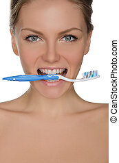 Portrait beautiful woman with toothbrush in teeth - Portrait...