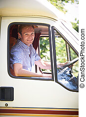 Man Driving Motor Home On Vacation