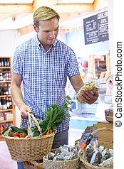 Male Customer Shopping In Farm Shop