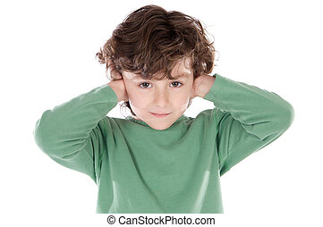 Child holding his hands against his ears a over white...