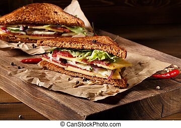 Two sandwich on old papper - Two pieces of sandwich on old...