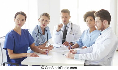 group of doctors meeting at seminar in hospital - hospital,...