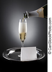 Champagne Invitation - Champagne pours into flute sitting on...