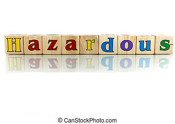 hazardous colorful wooden word block on the white background