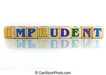 imprudent colorful wooden word block on the white background