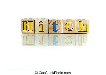 hitch colorful wooden word block on the white background