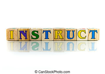 instruct - instruct colorful wooden word block on the white...