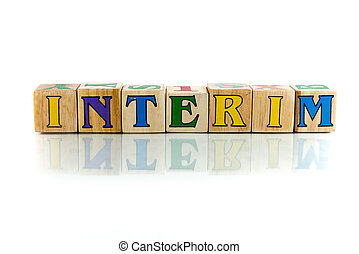 interim - interim colorful wooden word block on the white...