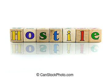 hostile colorful wooden word block on the white background