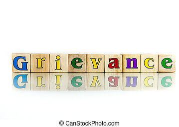 grievance - grievance colorful wooden word block on the...