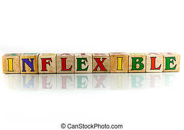 inflexible - inflexible colorful wooden word block on the...