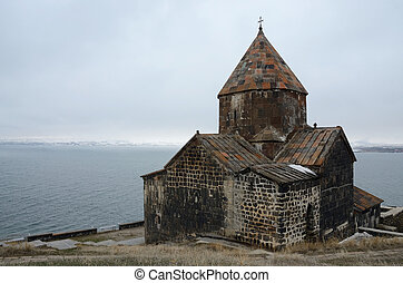 View of Surb Arakelots church in winter,Sevanavank orthodox...