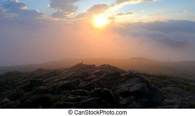 Mist and fog on mountain peak