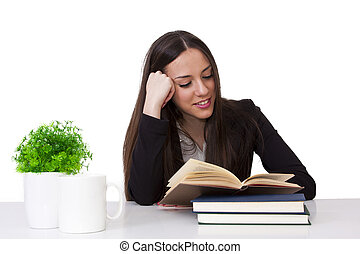 Business woman at the office reading