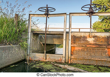 gates of irrigation channel - gates headgates and foot...