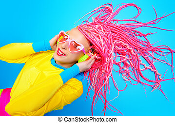 dreadlocks - Ultra trendy DJ party girl in bright clothes,...