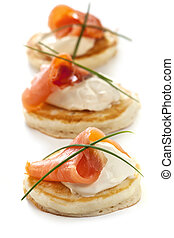Smoked Salmon Blinis - Blinis with smoked salmon and sour...