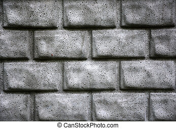 Grey brick wall as a background. Closeup view