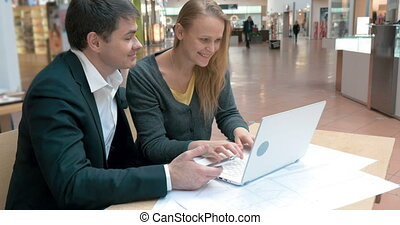 Young businesspeople working outside the office - Young...