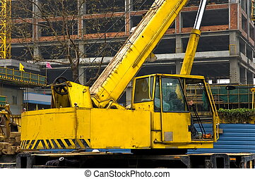 Telescopic crane control cabin and gib arm closeup - Yellow...