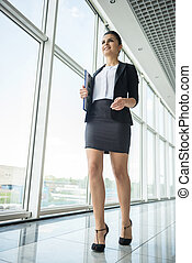 Businesslady - Young beautiful woman in suit at business...