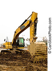 Yellow and black dirty excavator parked on the construction...