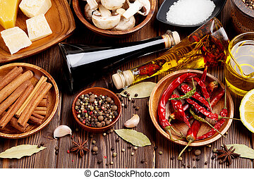 Various spices on wooden background Top view