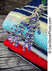 branches of blooming lavender and wool items - pure wool...
