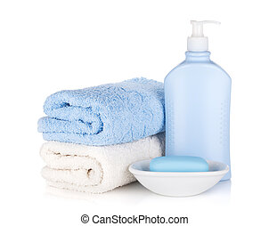 Shampoo bottle and soap with towels