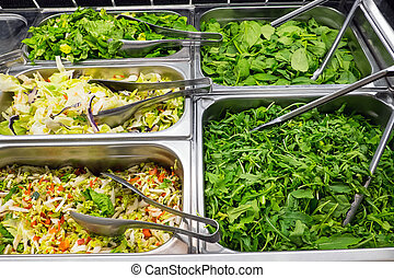 Different kinds of salad at a restaurant buffet