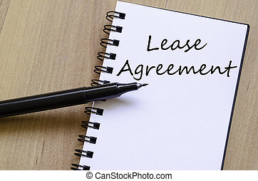 Lease agreement concept Notepad - White blank notepad on...