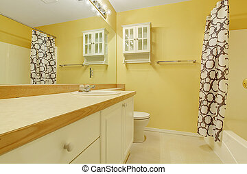 Perfect bathroom with yellow walls.
