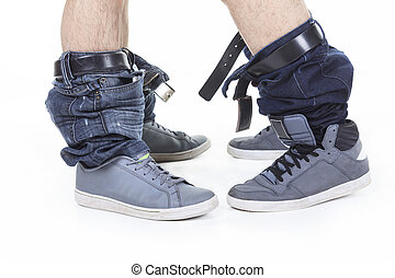 Homosexual jean at the bottom over white background on...