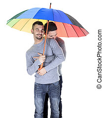 A homosexual couple over a white background on studio