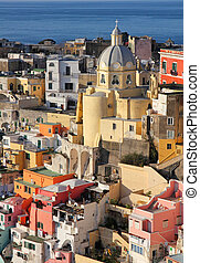 Italy. Gulf of Naples. Procida island. Colorful houses of...