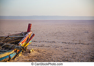 Abandoned colourful Boat in desert at dawn Tunisia -...