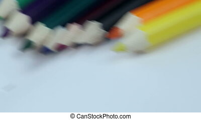 Colored Pencils Twelve Pieces Lie on White Paper. Smooth...