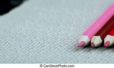 Colored Pencils Twelve Pieces Lie on White Cloth