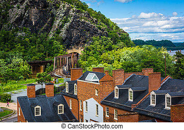 View of historic buildings and a railroad tunnel in Harpers Ferry, West Virginia.