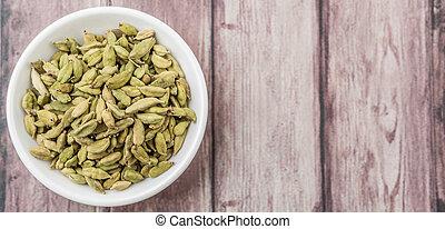 Cardamom Spice - Cardamom spice in a white bowl over...