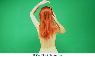 A slender girl with red hair - Rear view of a young Redhead...