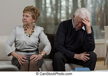 Angry woman and her husband - Having serious conflict in...