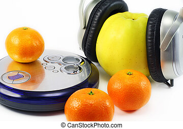 Fruit listens to music - Juicy ripe tangerines and huge...