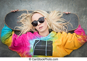 Skater Girl Lying Down - Blond skater girl laying down with...