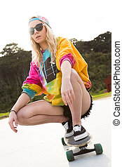Girl Riding Skateboard - Pretty blond girl riding skateboard