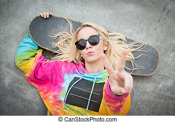 Skater Girl - Pretty blond skater girl giving peace sign