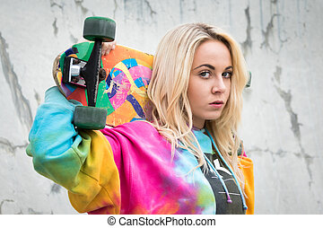 Girl Holding Skateboard - Pretty teenage girl holding...