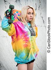 Blond Skater Girl - Blond skater girl holding skateboard