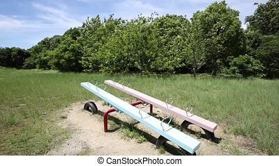 Empty seesaw in a park, playground for kids